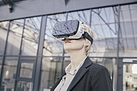 Businesswoman using Virtual Reality Glasses - FMKF03433