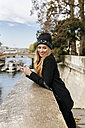 France, Paris, portrait of happy young woman with cell phone - MGOF02731