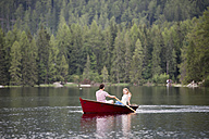 Young couple in rowing boat on the lake - HAPF01284