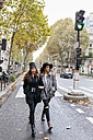 Paris, France, two young women walking on the street - MGOF02740