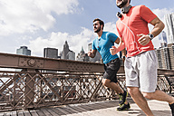 USA, New York City, two men running on Brooklyn Brige - UUF09682