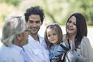 Smiling extended family outdoors - ZEF12330