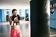 Young woman boxing in gym - JASF01449