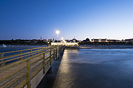 Germany, Usedom, Ahlbeck, view to lighted sea bridge with jetty in the foreground - SIEF07241