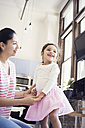Mother and daughter at home - WESTF22430