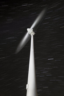 Wind wheel rotating with star trails in the background - DHCF00007