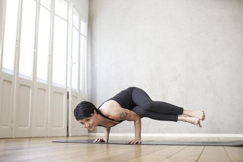Woman practising yoga - FMKF03449