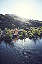 South Africa, Porterville, Beaverlac, man jumping into water - SRYF00189