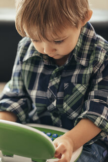 Boy using toy laptop - ZEDF00476