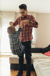 Father and son playing together at home - ZEDF00491