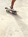Legs of young woman on skateboard - MGOF02773