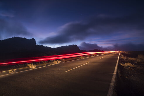 Spain, Tenerife, road with light trails in Teide National Park at night - SIPF01260