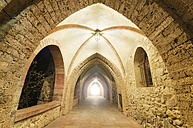 Spain, La Rioja, ancient monastery corridor with light at the end in Valvanera - DHC00034