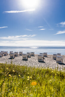 Germany, Schleswig-Holstein, Bay of Luebeck, hooded beach chairs on the beach - EGBF00169