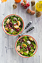 Two bowls with rocket, lychee, tangerine, cream cheese, walnuts, grapes and pomegranate seeds - SARF03112
