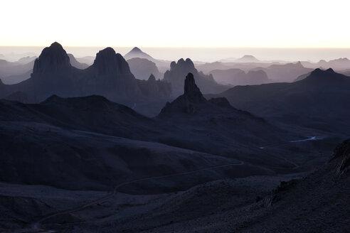 Algeria, Wilaya Tamanrasset, Hoggar Mountains, Assekrem in the mist - DSGF01413