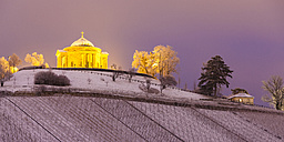 Germany, Stuttgart, view to lighted Wurttemberg Mausoleum with snow covered vineyards in the foreground - WDF03859
