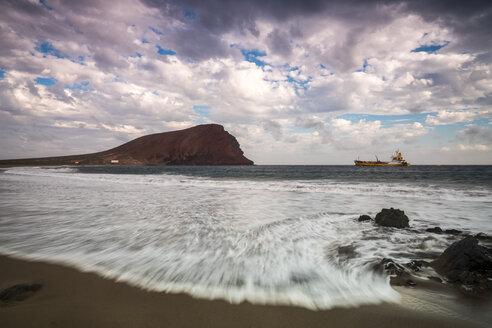 Spain, Tenerife, beach La Tejita with Montana Roja in the background at sunset - SIPF01293