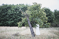 Wedding dress hanging in tree - ASCF00686