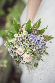 Close-up of bride holding bridal bouquet - ASCF00695