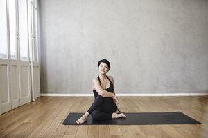Woman practising yoga - FMKF03481