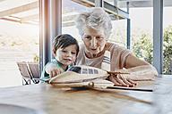 Grandson and grandmother playing with toy airplane - RORF00476