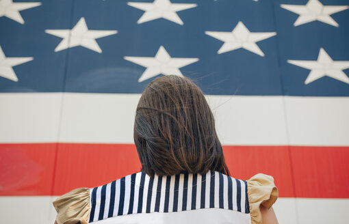 USA, back view of woman in front of Stars And Stripes - DAPF00543
