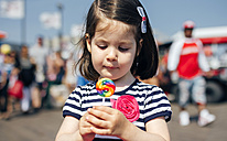 USA, New York, Coney Island, little girl with lollipop - DAPF00546