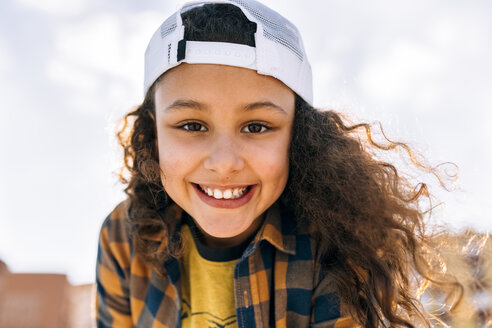 Portrait of happy girl wearing baseball cap - MGOF02809