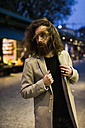 Stylish young man outdoors at night - MAUF00966