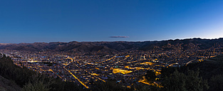 Peru, Andes, Cusco, cityscape as seen from Cristo Blanco Statue at blue hour - FOF08723