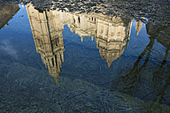 Spain, Toledo, water reflection of Toledo Cathedral in a puddle - SKCF00244