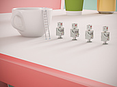 Row of four miniature robots on tabletop, 3D Rendering - UWF01107