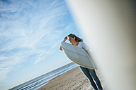 Young woman with surfboard on the beach - KIJF01088
