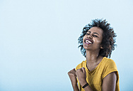 Portrait of excited young woman - UUF09775
