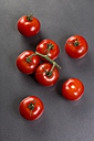 Vine tomatoes on grey ground - JUNF00766