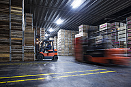 Man on forklift in factory hall - ZEF12454