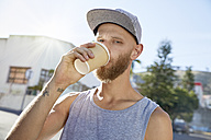 Portrait of young man drinking coffee to go - SRYF00200