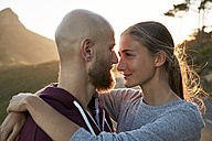 Young couple in love face to face at backlight - SRYF00239