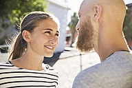 Portrait of young woman face to face to her partner - SRYF00242