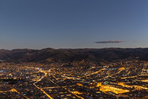 Peru, Andes, Cusco, cityscape as seen from Cristo Blanco Statue at sunset - FOF08736