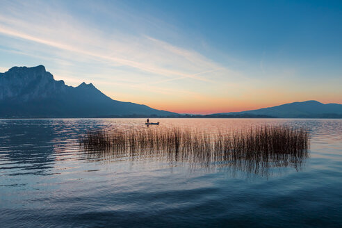 Austria, Mondsee, fishing boat on Lake Mondsee at dusk - WVF00795