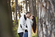 Happy couple kissing in the forest - HAPF01296