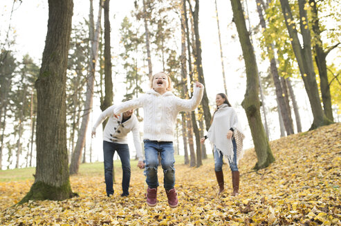 Happy girl with family in autumnal forest - HAPF01317
