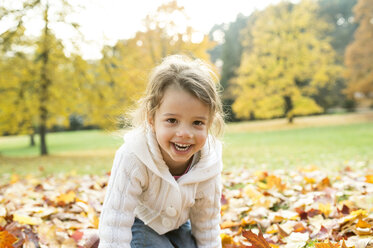Portrait of happy girl in autumn leaves - HAPF01320