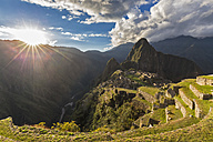 Peru, Andes, Urubamba Valley, Machu Picchu with mountain Huayna Picchu at sunset - FOF08765