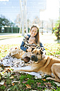 Happy woman with baby and dog in park - VABF01042
