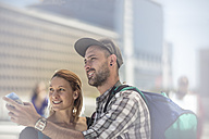 Backpacker couple searching for directions in the city - ZEF12474
