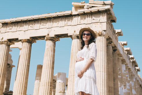 Greece, Athens, pregnant woman visiting the Parthenon temple on the Acropolis - GEMF01410