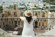 Greece, Athens, woman looking at The Odeon of Herodes Atticus at the slope of the Acropolis - GEMF01413